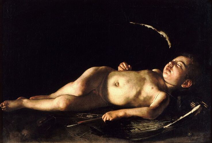 Sleeping Cupid by Caravaggio in the Palazzo Pitti in Florence