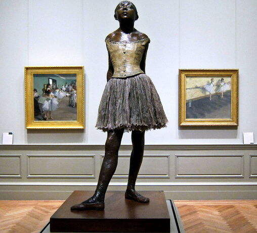 The Little Fourteen-Year-Old Dancer by Edgar Degas in the Metropolitan Museum of Art with two Degas paintings in the background