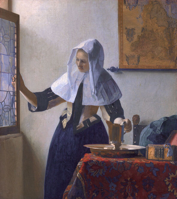 Young Woman with a Water Pitcher by Johannes Vermeer in the Metropolitan Museum of Art in New York