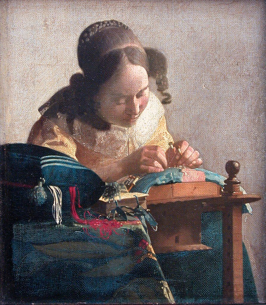 The Lacemaker by Johannes Vermeer in the Louvre Museum in Paris